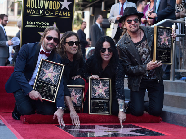 Mana Honored With Star On The Hollywood Walk Of Fame [mana honored with star on the hollywood walk of fame,carpet,red carpet,event,flooring,premiere,games,fher olvera,juan calleros,alex gonzalez,sergio vallin,rock band,man\u00e3,hollywood walk of fame,mexican,ceremony]