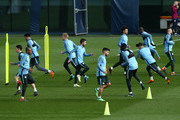 Manchester City players warm up during a training session at Manchester City Football Academy on April 9, 2018 in Manchester, England.