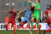 Jill Scott (C) of Manchester City Women is beaten to the ball by Ann-Katrin Berger (R) of Birmingham City Ladies during the Continental Cup Final between Manchester City Women and Birmingham City Ladies at The Academy Stadium on October 2, 2016 in Manchester, England.