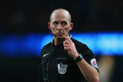 Referee Mike Dean during the Barclays Premier League match between Manchester City and Arsenal at the Etihad Stadium on January 18, 2015 in Manchester, England.