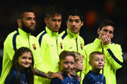 (L-R)  Daniel Alves, Lionel Messi, Luis Suarez and Neymar of Barcelona  line up during the UEFA Champions League Round of 16 match between Manchester City and Barcelona at Etihad Stadium on February 24, 2015 in Manchester, United Kingdom.