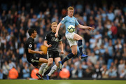 Kevin De Bruyne of Manchester City controls the ball while under pressure from Jack Cork of Burnley during the Premier League match between Manchester City and Burnley FC at Etihad Stadium on October 20, 2018 in Manchester, United Kingdom.