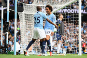 Leroy Sane of Manchester City celebrates with teammate Fernandinho after scoring his team's first goal during the Premier League match between Manchester City and Fulham FC at Etihad Stadium on September 15, 2018 in Manchester, United Kingdom.