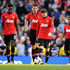 (L-R) Danny Welbeck, Michael Carrick, Wayne Rooney and Luis Antonio Valencia of Manchester United look dejected as Yaya Toure of Manchester City (not pictured) scores their second goal during the Barclays Premier League match between Manchester City and Manchester United at the Etihad Stadium on September 22, 2013 in Manchester, England.
