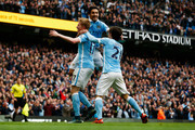 Kevin de Bruyne of Manchester City celebrates scroring his first goal with team mates during the Barclays Premier League match between Manchester City and Newcastle United at Etihad Stadium on October 3, 2015 in Manchester, United Kingdom.