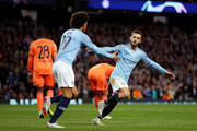 David Silva of Manchester City celebrates after scoring his team's first goal with Leroy Sane of Manchester City during the Group F match of the UEFA Champions League between Manchester City and Olympique Lyonnais at Etihad Stadium on September 19, 2018 in Manchester, United Kingdom.