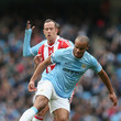 Vincent Kompany and Charlie Adam