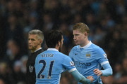 David Silva (L) of Manchester City replaces Kevin de Bruyne (R) during the Barclays Premier League match between Manchester City and Swansea City at Etihad Stadium on December 12, 2015 in Manchester, United Kingdom.