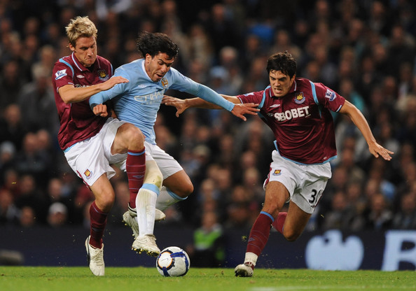 Radoslav Kovac and Alessandro Diamanti (R) of West Ham United challenge Carlos Tevez of Manchester City during the Barclays Premier League match between Manchester City and West Ham United at the City of Manchester Stadium on September 28, 2009 in Manchester, England.