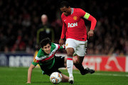 Patrice Evra of Manchester United goes past Andoni Iraola of Athletic Bilbao during the UEFA Europa League Round of 16 first leg match between Manchester United and Athletic Bilbao at Old Trafford on March 8, 2012 in Manchester, England.