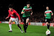 Andoni Iraola of Athletic Bilbao competes with Ji-Sung Park of Manchester United during the UEFA Europa League Round of 16 first leg match between Manchester United and Athletic Bilbao at Old Trafford on March 8, 2012 in Manchester, England.