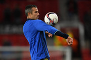 Robin van Persie of Fenerbahce warms up prior to the UEFA Europa League Group A match between Manchester United FC and Fenerbahce SK at Old Trafford on October 20, 2016 in Manchester, England.