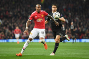 Ashley Young of Manchester United battles Wissam Ben Yedder of Seville during the UEFA Champions League Round of 16 Second Leg match between Manchester United and Sevilla FC at Old Trafford on March 13, 2018 in Manchester, United Kingdom.