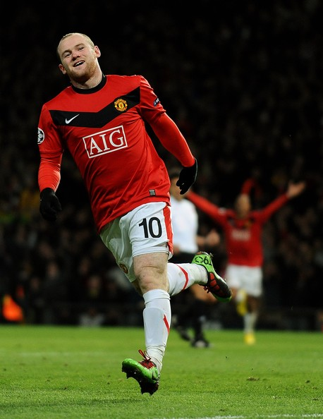 Wayne Rooney of Manchester United celebrates  scoring the 2nd goal during the UEFA Champions League First Knockout  Round, second leg match between Manchester United and AC Milan at Old  Trafford on March 10, 2010 in Manchester, England.