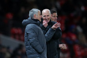 Jose Mourinho the head coach / manager of Manchester United speaks with fourth official Mike Dean during the Premier League match between Manchester United and AFC Bournemouth at Old Trafford on December 13, 2017 in Manchester, England.