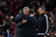 Jose Mourinho, Manager of Manchester United and Viktor Goncharenko, Manager of CSKA Moscow embrace after the UEFA Champions League group A match between Manchester United and CSKA Moskva at Old Trafford on December 5, 2017 in Manchester, United Kingdom.
