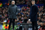 Jose Mourinho, Manager of Manchester United and Viktor Goncharenko, head coach of CSKA Moscow look on during the UEFA Champions League group A match between Manchester United and CSKA Moskva at Old Trafford on December 5, 2017 in Manchester, United Kingdom.