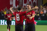 Juan Mata #8 of Manchester United celebrates his goal with Matteo Darmian #36 during the second half of the International Champions Cup game against the Club America at the University of Phoenix Stadium on July 19, 2018 in Glendale, Arizona.