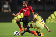 Juan Mata #8 of Manchester United and Guido Rodriguez #5 of Club America in action during the International Champions Cup game at the University of Phoenix Stadium on July 19, 2018 in Glendale, Arizona.