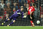 Scott Carson of Derby County saves the Eighth penalty from Phil Jones of Manchester United, putting Derby County through to the next round of the cup during the Carabao Cup Third Round match between Manchester United and Derby County at Old Trafford on September 25, 2018 in Manchester, England.