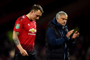 Jose Mourinho, Manager of Manchester United applauds fans as Phil Jones of Manchester United looks dejected after missing his team's eighth penalty, meaning Derby County win the match on penalties during the Carabao Cup Third Round match between Manchester United and Derby County at Old Trafford on September 25, 2018 in Manchester, England.