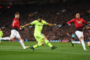 Luis Suarez of Barcelona shoots during the UEFA Champions League Quarter Final first leg match between Manchester United and FC Barcelona at Old Trafford on April 10, 2019 in Manchester, England.