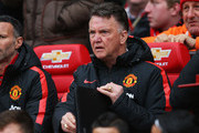 Louis van Gaal manager of Manchester United looks on from the bench prior to the Barclays Premier League match between Manchester United and Manchester City at Old Trafford on April 12, 2015 in Manchester, England.