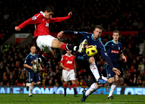 Javier Hernandez of Manchester United shoots at goal under pressure from Robert Huth of Stoke City during the Barclays Premier League match between Manchester United and Stoke City at Old Trafford on January 4, 2011 in Manchester, England.