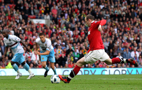 Wayne Rooney of Manchester United scores the opening goal from the penalty spot during the Barclays Premier League match between Manchester United and West Ham United at Old Trafford on August 28, 2010 in Manchester, England.