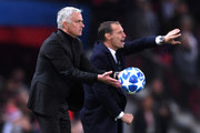 Jose Mourinho, Manager of Mancthester United throws the ball during the Group H match of the UEFA Champions League between Manchester United and Juventus at Old Trafford on October 23, 2018 in Manchester, United Kingdom.