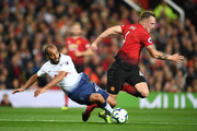 Lucas Moura of Tottenham Hotspur is tackled by Phil Jones of Manchester United during the Premier League match between Manchester United and Tottenham Hotspur at Old Trafford on August 27, 2018 in Manchester, United Kingdom.