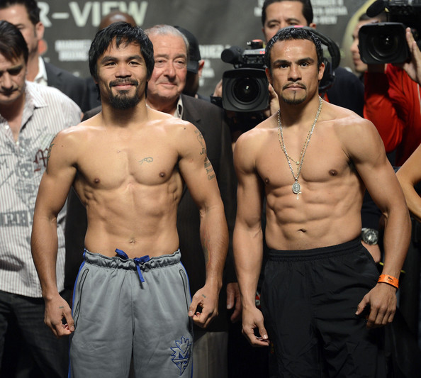 Manny Pacquiao v Manuel Marquez - Weigh In [barechested,muscle,chest,abdomen,model,trunk,flesh,bodybuilding,juan manuel marquez,manny pacquiao,boxers,each other,las vegas,mgm grand garden arena,nevada,l,weigh-in,welterweight bout]