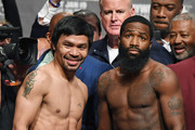 WBA welterweight champion Manny Pacquiao (L) and Adrien Broner pose during their official weigh-in at MGM Grand Garden Arena on January 18, 2019 in Las Vegas, Nevada. Pacquiao will defend his title against Broner on January 19 at MGM Grand Garden Arena in Las Vegas.
