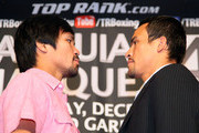 (L-R) Manny Pacquiao and Juan Manuel Marquez stand face-to-face onstage in front of the media cameras during the Manny Pacquiao v Juan Manuel Marquez - Press Conference at Beverly Hills Hotel on September 17, 2012 in Beverly Hills, California.