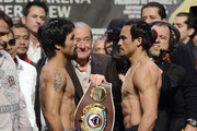 Boxers Manny Pacquiao (L) and Juan Manuel Marquez face off during the official weigh-in for their welterweight bout at the MGM Grand Garden Arena on December 7, 2012 in Las Vegas, Nevada. Pacquiao and Marquez will fight each other for the fourth time on December 8 in Las Vegas.