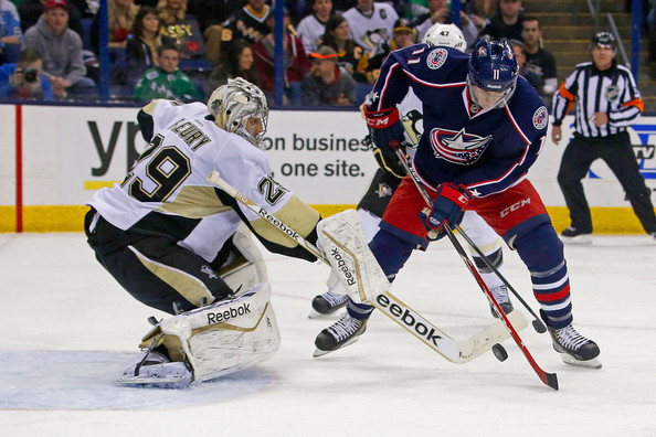Marc-Andre Fleury Marc-Andre Fleury #29 of the Pittsburgh Penguins knocks the puck away from Matt Calvert #11 of the Columbus Blue Jackets during the second period on March 28, 2014 at Nationwide Arena in Columbus, Ohio.