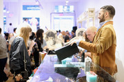 Designer Marc Jacobs (R) works the counter at THE Marc Jacobs SoHo Block Party at The Marc Jacobs SoHo Store on June 12, 2019 in New York City.