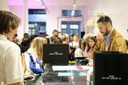Marc Jacobs (R) works the register during THE Marc Jacobs SoHo Block Party at The Marc Jacobs SoHo Store on June 12, 2019 in New York City.