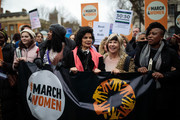 Protesters including Labour politician Dawn Butler (2ndL) and social and human rights campaigner Bianca Jagger (C) march to Trafalgar Square during the March4Women event on March 4, 2018 in London, England. Demonstrators march through central London today with calls for an end to gender-based discrimination in the workplace. The event celebrates the upcoming International Women's Day, on March 8th, and marks 100 years since the first women in the UK gained the right to vote.