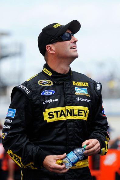 Marcos Ambrose, driver of the #9 Stanley Ford, stands on the grid during qualifying for the NASCAR Sprint Cup Series FedEx 400 benefiting Autism Speaks at Dover International Speedway on June 2, 2012 in Dover, Delaware. (June 1, 2012 - Source: Patrick McDermott/Getty Images North America)