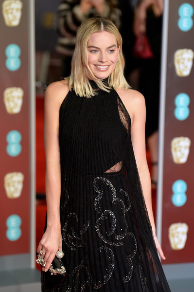 EE British Academy Film Awards - Red Carpet Arrivals [clothing,dress,fashion model,red carpet,carpet,long hair,hairstyle,fashion,premiere,little black dress,red carpet arrivals,margot robbie,ee,england,london,royal albert hall,british academy film awards]