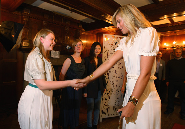 Maria Sharapova, international tennis star and global brand ambassador for Sony Ericsson meets with the winning student Georgie Davies (L) at Liberty store as she unveils winning designs from students at the London College of Fashion on June 17, 2009 in London, England.