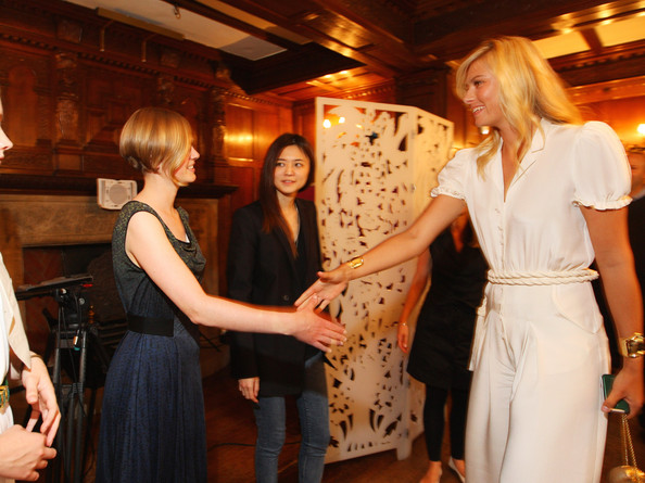 Maria Sharapova, international tennis star and global brand ambassador for Sony Ericsson meets with one of the winning students of London College of Fashion Lova Moller at Liberty store as she unveils winning designs from students at the London College of Fashion on June 17, 2009 in London, England.