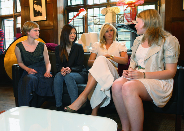 Maria Sharapova, international tennis star and global brand ambassador for Sony Ericsson has a chat with the winning students of London College of Fashion Lova Moller (L), Cecilia Ku (centre left) and the winner Georgie Davies at Liberty store as she unveils winning designs from students at the London College of Fashion on June 17, 2009 in London, England.