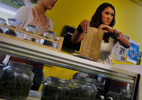 Marijuana saleswoman Marissa Dodd (R) bags up a marijuana sale at the Dr. Reefer marijuana dispensary April 20, 2010 across from the University of Colorado in Boulder, Colorado.   Dr. Reefer is one of several legal marijuana dispensaries in Boulder, and sell their different varieties of marijuana to anyone possessing a medical marijuana card issued by the state.  Colorado, one of 14 states to allow use of medical marijuana, has experienced an explosion in marijuana dispensaries, trade shows and related businesses in the last year as marijuana use becomes more mainstream here.