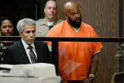"""Marian """"Suge"""" Kinght (R) and his Lawyer David E Kenner (L) appear at his arraignmet at Compton Courthouse on February 3, 2015 in Compton, California.  Knight is charged with murder and attempted murder after a hit-and-run incident following an argument in a parking lot on January 29."""