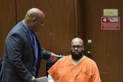 """Marion """"Suge"""" Knight, right, appears in court with his new lawyer Matthew P. Fletcher at the Clara Shortridge Foltz Criminal Justice Center March 9, 2015 in Los Angeles, California.  The hearing was scheduled to determine if the two criminal cases against Knight, one for murder and attempted murder when Knight allegedly ran over two men in a Compton parking lot after an argument and another case involving an alleged robbery and criminal threats to a photographer in Beverly Hills, should be moved to the downtown Los Angeles courthouse."""