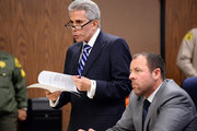 """Marion """"Suge"""" Knight attends Compton Court House for his bail hearing with his lawyers David Kenner (L) and Brett Greenfield at Compton Courthouse on February 9, 2015 in Compton, California."""