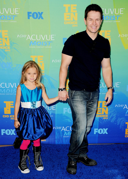 Mark Wahlberg Actor Mark Wahlberg (R) and guest arrive at the 2011 Teen Choice Awards held at the Gibson Amphitheatre on August 7, 2011 in Universal City, California.