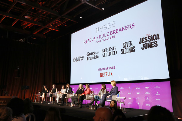 Rebels And Rule Breakers Panel At Netflix FYSEE [rebels,debra birnbaum,liz flahive,venna sud,melissa rosenberg,marta kauffman,carly mensch,cindy holland,stage,projection screen,event,text,display device,academic conference,convention,presentation,technology,design,netflix fysee,rule breakers panel]